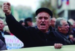 A pensioner raises his arm during an anti-austerity rally in Athens